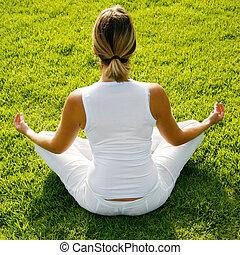 Yoga - Woman in white doing yoga in dawn light