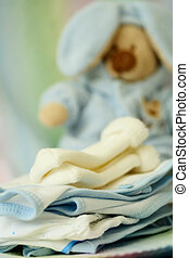 Baby clothing - A shot of baby clothing and doll at a...