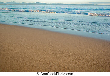 beach scene - a nice beach scene with gentle waves reaching...