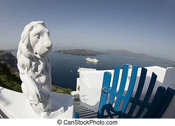 statue over harbor santorini greek island fish-eye view