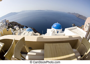 view over greek island churches - fish-eye bird\\\'s eye...