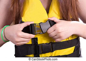 Buckle Up - Girl Fastening buckle on life jacket/ski vest