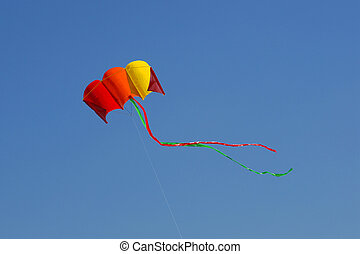 Flying kite on the blue sky