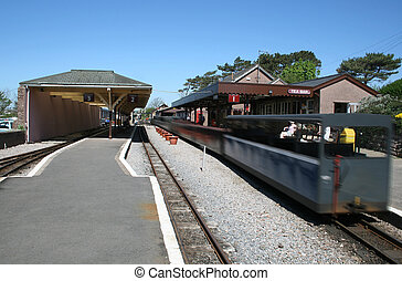 narrow gauge railway station - train just leaving from a...