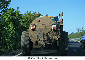 silage tank being pulled along by a tractor
