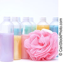 rainbow of bath supplies in pastel colors, including bottles...