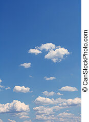 Blue sky - White clouds on a blue sky background