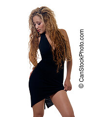 Little black dress - Attractive woman with long curly blond...