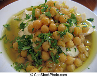 Hummus Middle East food - Dish of fresh Hummus with olive...