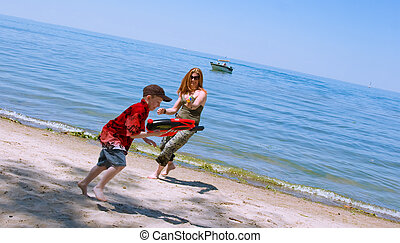 Mother and Son playing at the beach