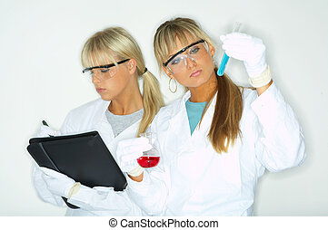 Female in lab - Beautiful female lab workers testing and...