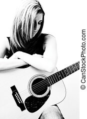 Women with accoustic guitar - Thirty something women sitting...