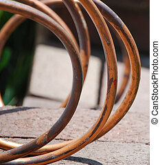copper tubing - abstract image of old coiled copper tubing