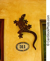 Iguana Decor - Stylized decorative iguana and room number at...