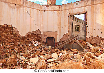 rubble and fireplace - an old farm house lays in ruins and...