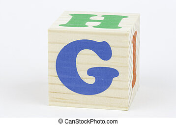 letter G - isolated brick on the white background, focus...