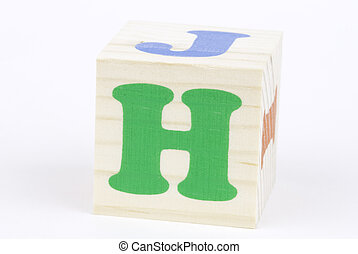 letter H - isolated brick on the white background, focus...
