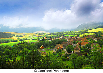 Rural landscape with hills and village in eastern France