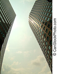 Twin skyscapers - modern building from below. Modern...