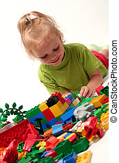 Cube blocks - Little girl playing with colorful cube blocks