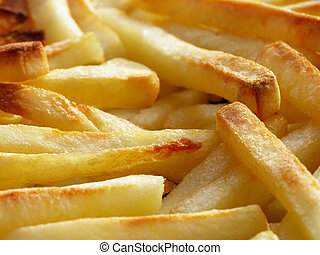 pommes frites - Close-up of oily french fries as a...