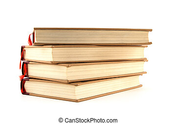 Four hardcover books on white background - Four stacked...