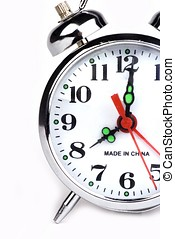 Alarm Clock - An antique alarm clock in white background