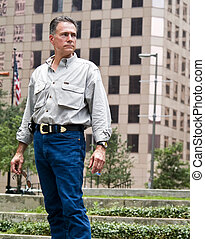 Urban Dweller - A man standing downtown with the background...