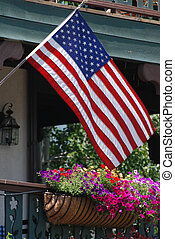 American Flag on porch - American flag hung on parch with...