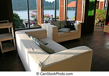 Sofa seaside - White fabric sofa with a view of the seaside