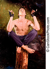 Missionary - Man with naked torso sitting on beam at...