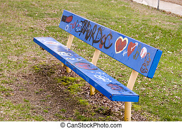 Park Bench - Grafitti on an old blue park bench