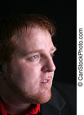 Man\\\'s face close up - A man\\\'s face close up is looking...