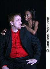 Racially mixed copule - A racially mixed cople together in...