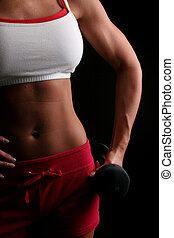 Womans strength - A strong arm and well cut abdomen of a...
