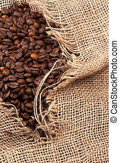 coffe beans in sack - brown coffe breans in a tattered...
