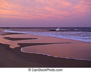 Sunset Reflection - A beautiful sunset reflects in the surf...