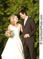 wedding couple - a marriage pair is happy in a green park