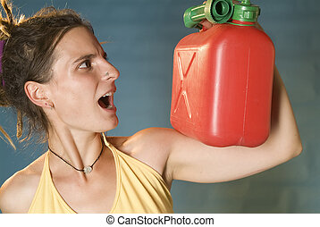 woman looks at petrol can - a young woman looks to the red...