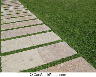 Stone Path on the Grass - Flagstones Forming A Diagonal Path...