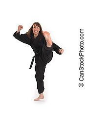woman doing karate over white background