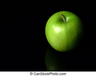 Right Green Apple - A green apple on a black background.