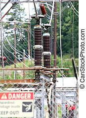 Danger High Power - A warning sign on a fence around high...