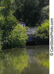 Boat House - Reflections of trees and boat house in water