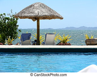Fijian Seascape - Poolside at a beach resort on Denarau...