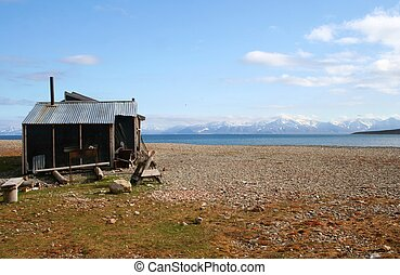 Old Shack - An old wooden shack in the Svalbard region of...