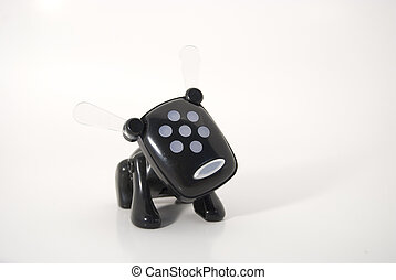 Black toy dog - Little black plastic toy dog isolated...