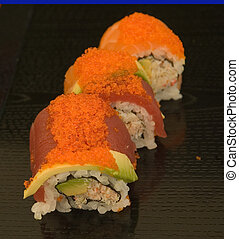 Sushi plates with shallow depth of field - A series of sushi...