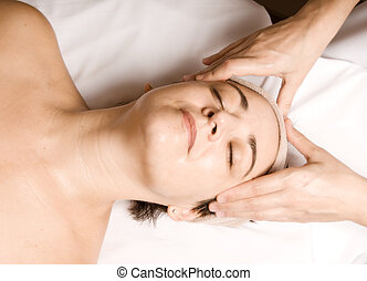Massage - woman relaxing with a nice facial massage