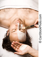 Beauty treatment - man relaxing with a nice facial lotion